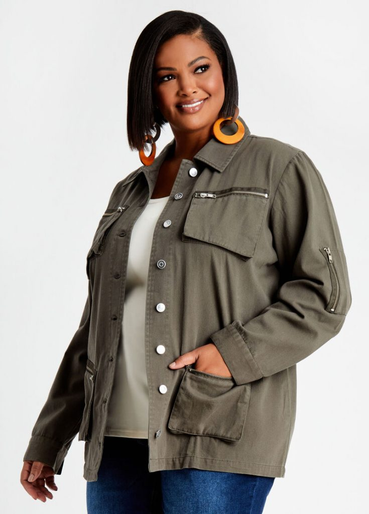 Woman wearing gray utility jackets with zip detail