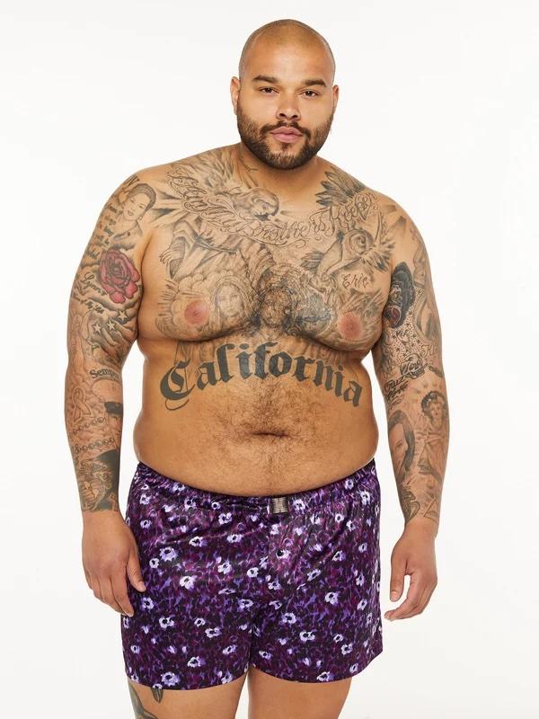 a plus size man wearing silk boxer shorts