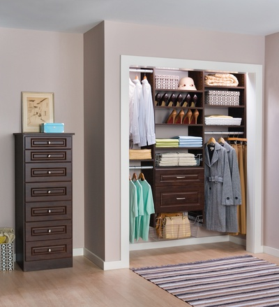 Woman's Efficient Reach-In Closet