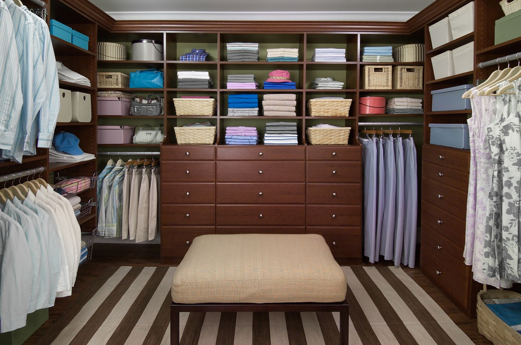Grand Walk-In Closet with Bench