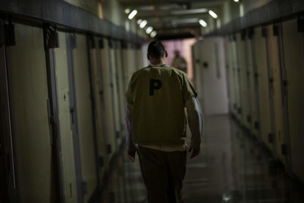 An inmate walks down one of the hallways of Worcester County Jail & House of Correction. (Jesse Costa/WBUR)