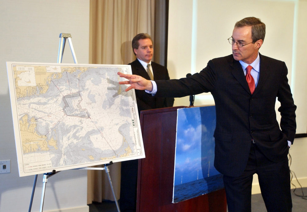 Cape Wind's Jim Gordon gestures toward a nautical chart of the project as GE's Steven Zwolinski looks on during a 2002 press conference. (Patrick Whittemore/Boston Herald via Getty Images)