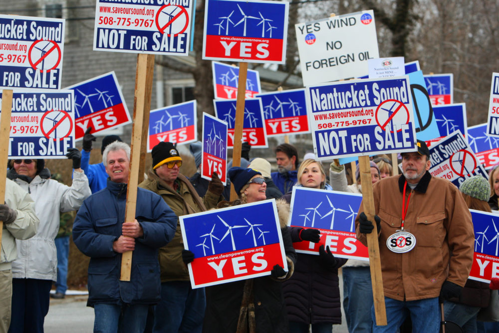 Supporters and protestors of Cape Wind protest in Woods Hole during a 2010 visit from then-Interior Secretary Ken Salazar. (Joanne Rathe/The Boston Globe via Getty Images)