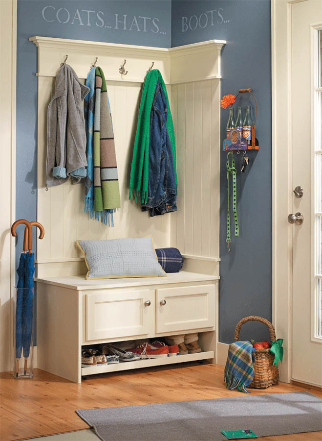 Cure the clutter with this mudroom organizer... A bench and wall treatment offer a built-in look for a stylish storage solution.