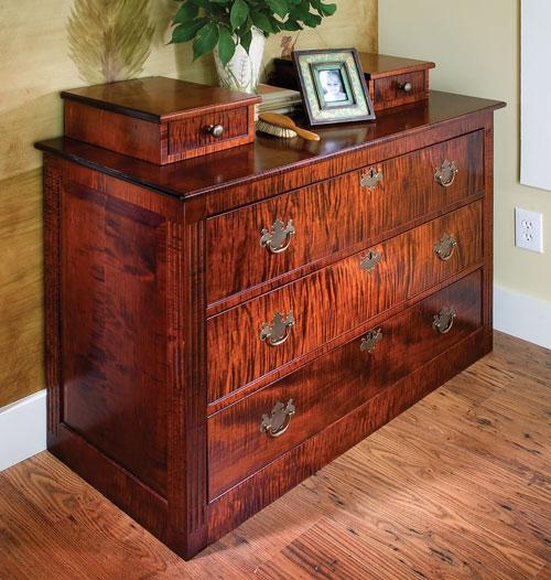 This 3-drawer dresser is simple in its construction but boasts features such as fluted columns, beaded drawers, and two small drawers on its top that make it look elegant and top-of-the-line.