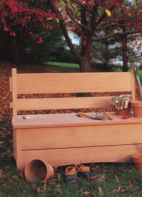 Add a place to sit and storage for all your garden tools with this durable redwood bench.