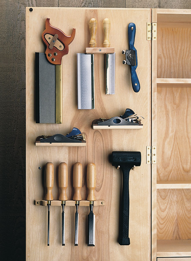 With unique tool holders and adjustable shelves, you can customize this wall-mounted plywood tool cabinet to organize and protect all of your special hand and power tools.