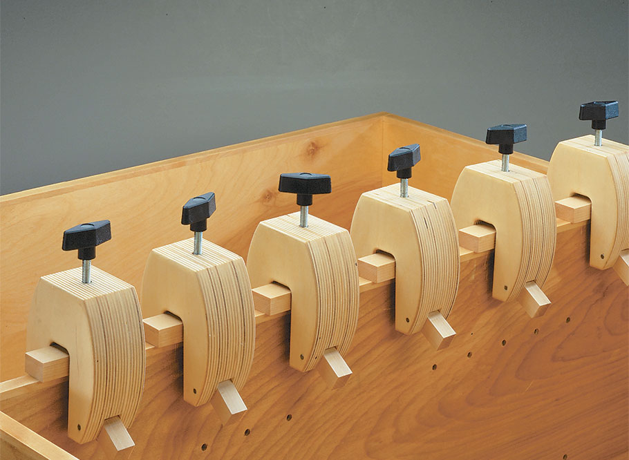 These shop-made edge clamps are bound to come in handy when gluing hardwood edging on plywood.