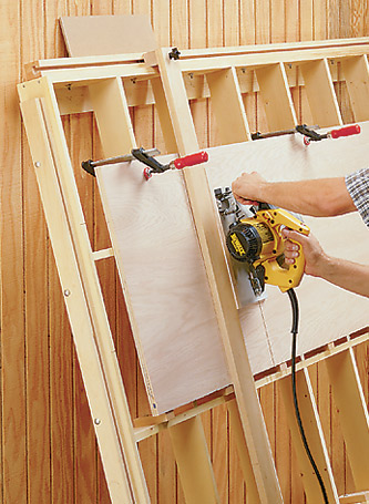 It's easy to cut sheet goods down to size with this tilt-out panel cutting guide.