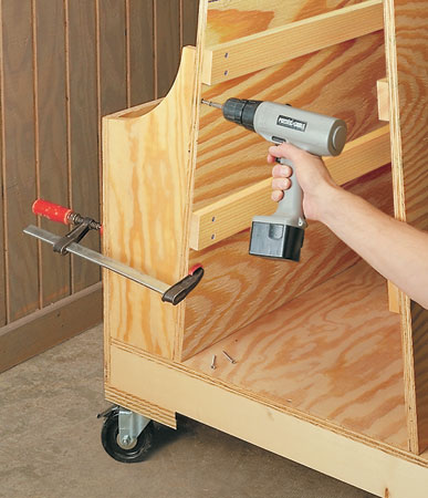 Need a better way to store lumber? This easy-to-build cart has space for plywood, long boards, and all of your cutoffs too.