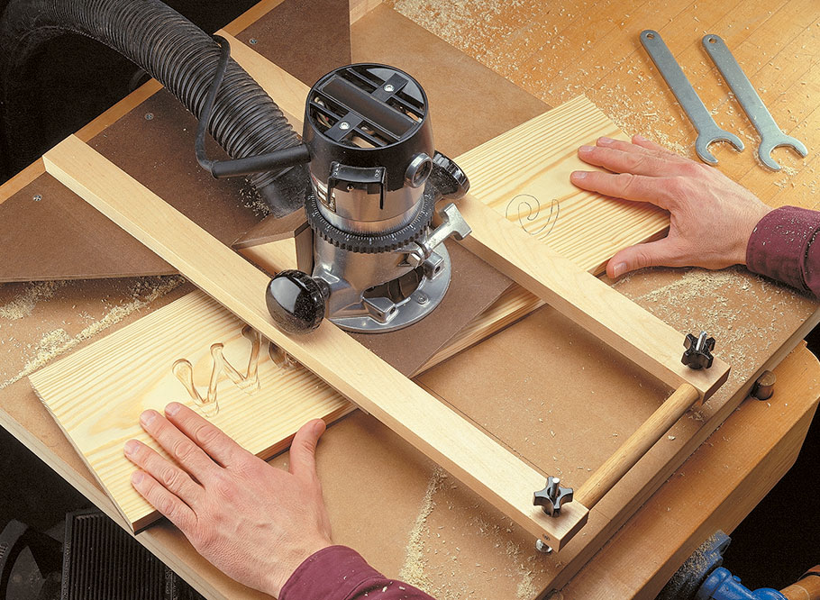 With a hand-held router and this jig, you can rout a wide variety of decorative designs in your projects. A metal pin and a shop-made template guide the workpiece while you rout the design.