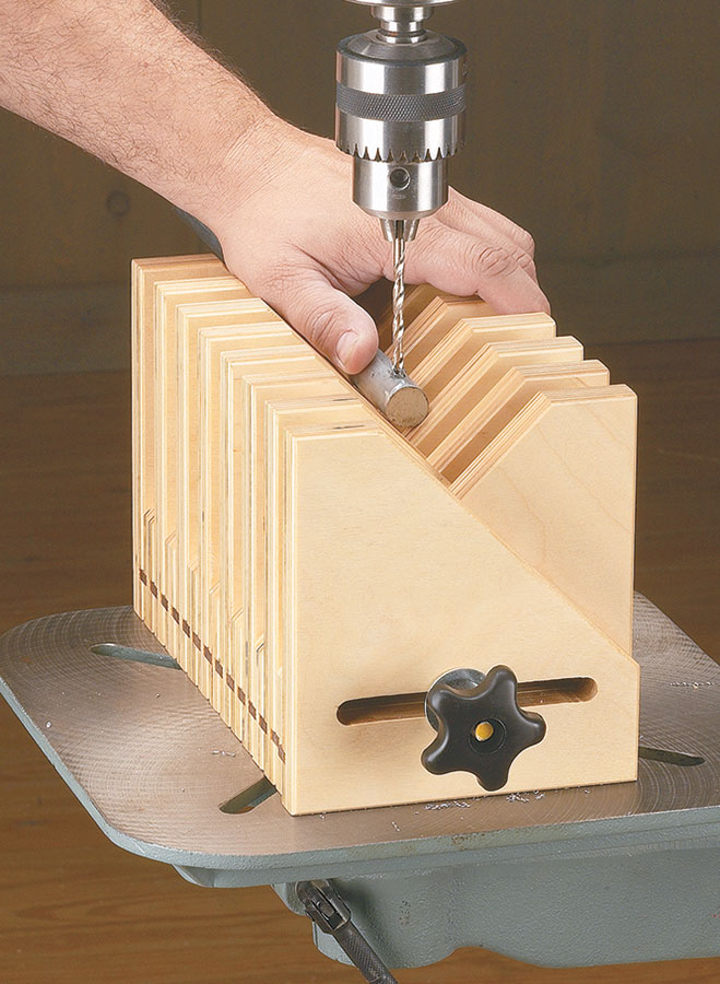 Angled holes and odd-shaped workpieces are no match for this handy drill press accessory.