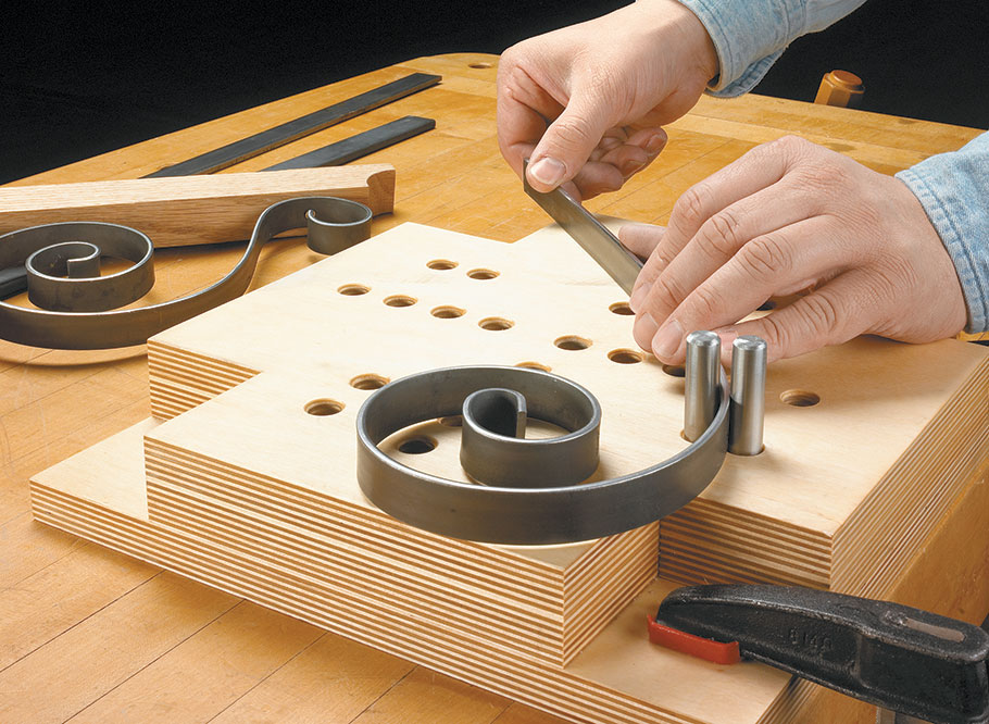 This simple jig allows you to bend metal rods and bars into decorative shapes and useful objects with ease.