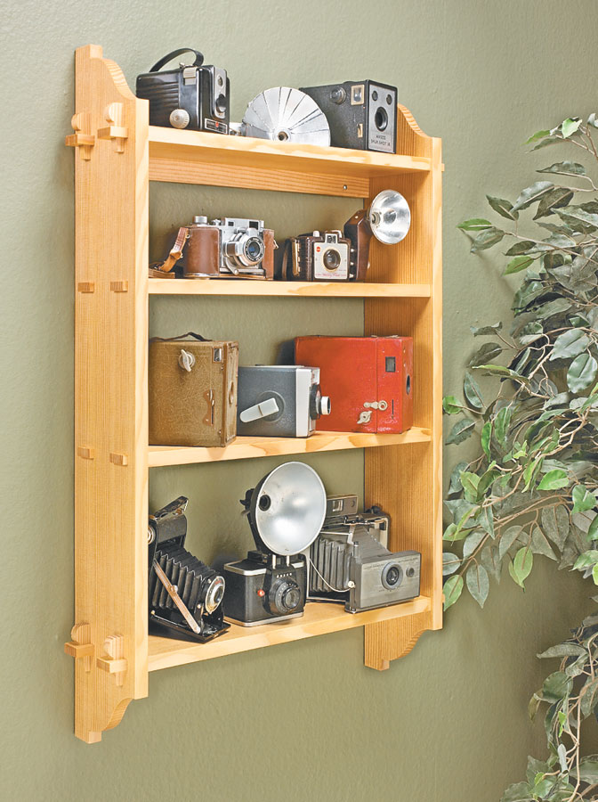 This wall shelf has joinery that gives it a traditional look, making it the perfect home for shop tools or display pieces.