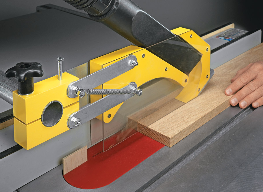 Stop table saw dust in its tracks. All it takes is a weekend, some hardware, and an ordinary shop vacuum crevice tool.