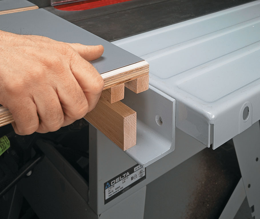 This addition to your table saw takes the hassle out of cutting long boards and sheet goods. And it stores away easily when you're done.