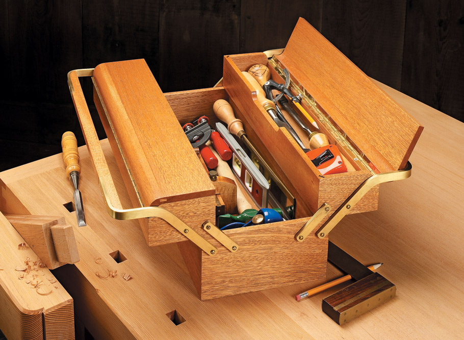 Tote your hand tools, tackle, or craft supplies in style with this one-of-a-kind wooden tool box.