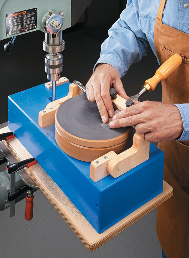 Powered by a drill press, this sandpaper sharpening system guarantees a keen edge on your tools.