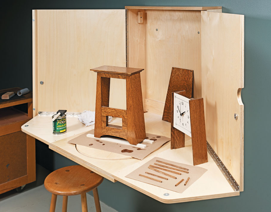 This wall-mounted cabinet provides a dedicated worksurface for applying finishes to small projects.