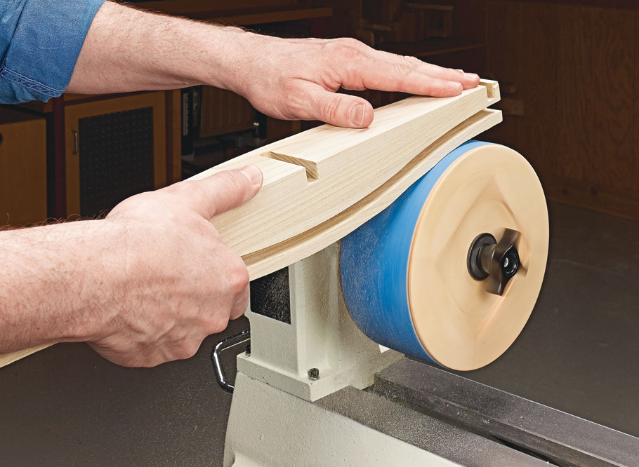 Turn your lathe into a double-duty machine with a standard sanding belt and this shop-made drum.