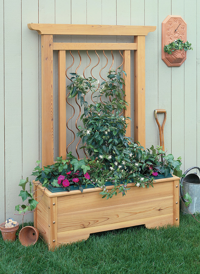 Curved copper climbing supports and solid cedar construction . . . together they're the perfect pair to create an all-in-one planter and trellis.
