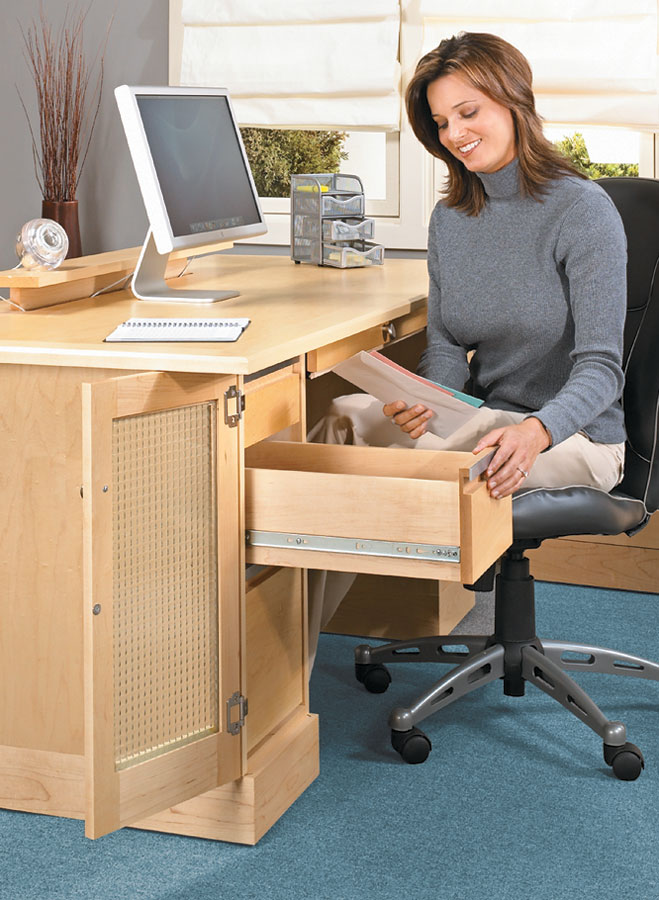 This desk features a huge worksurface and lots of storage. One of the handiest features is a removable panel for computer ventilation and wire access.