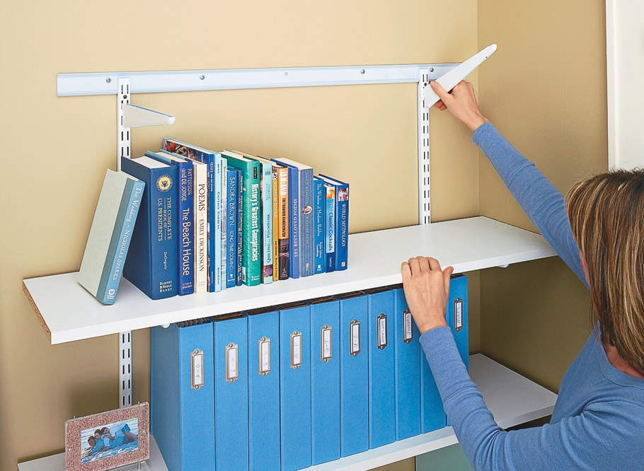 Turn simple shelving and basic home center supplies into a great basement office area that serves the needs of the whole family without taking up a lot of space.
