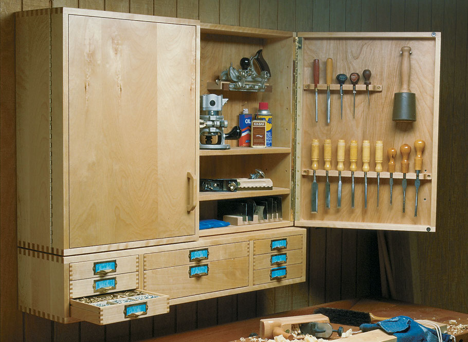 This wall-mounted cabinet keeps your hand tools nearby, and the drawers are perfect for organizing all of your hardware.