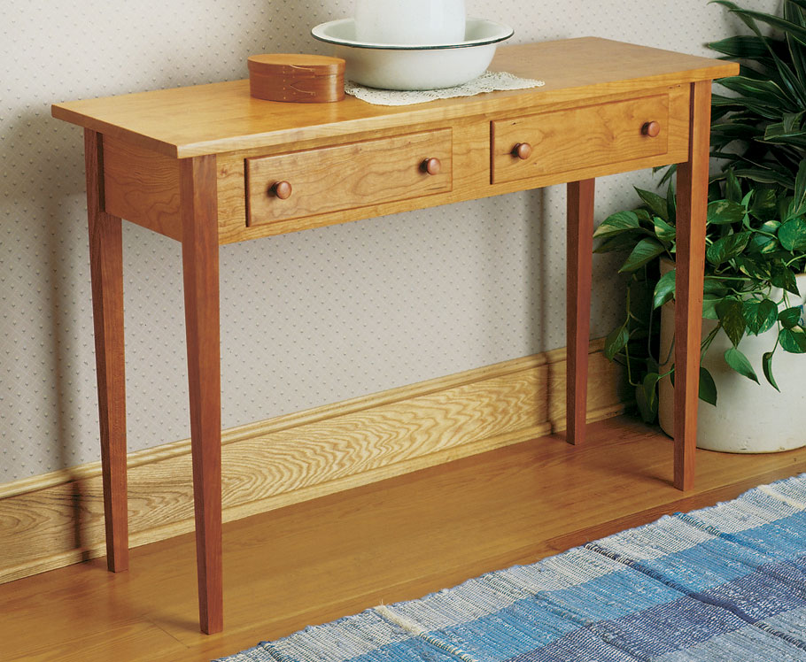A solid cherry hall table inspired by the timeless quality and clean, uncomplicated lines of Shaker design.