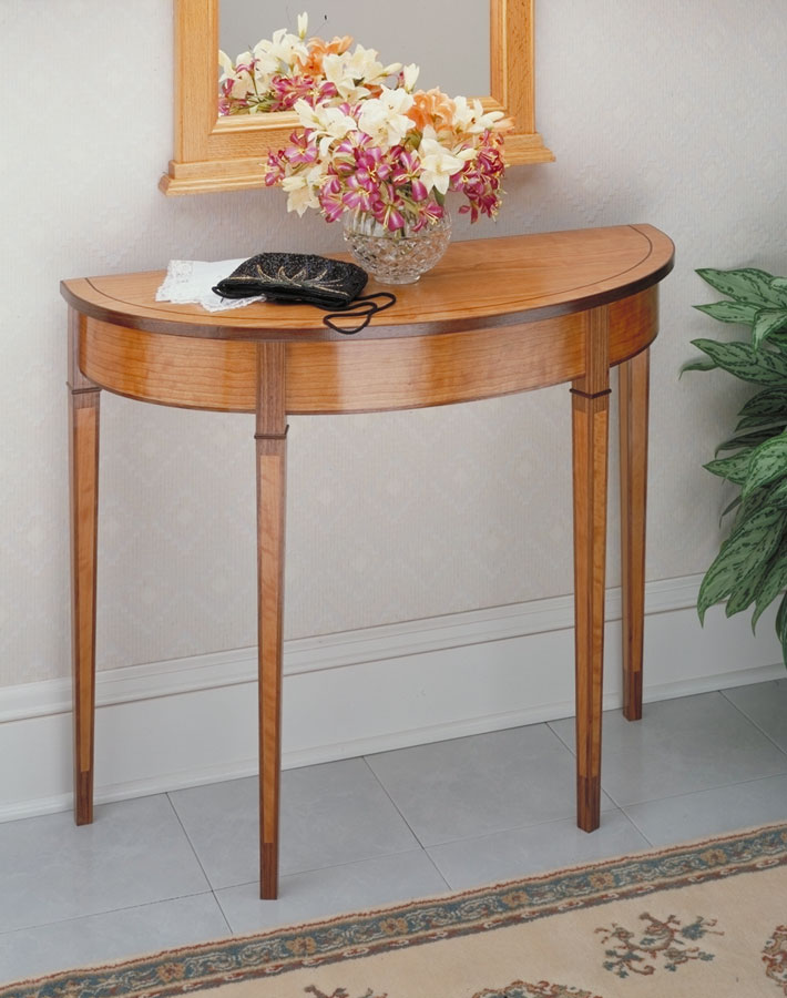 A curved apron and tapered legs with inlays really set this classic table apart from the crowd.