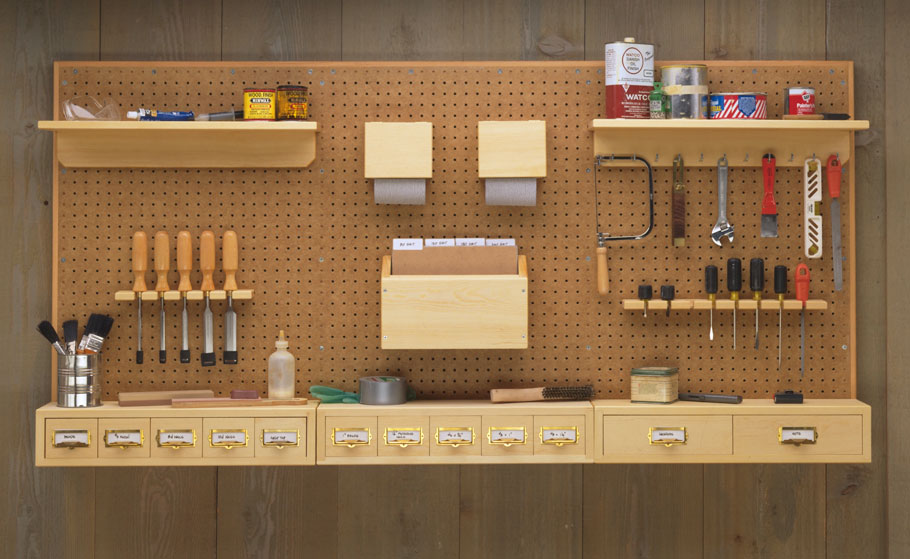 Here's a tool rack that takes a different approach to using common pegboard. You can customize it to fit your needs and your tools.