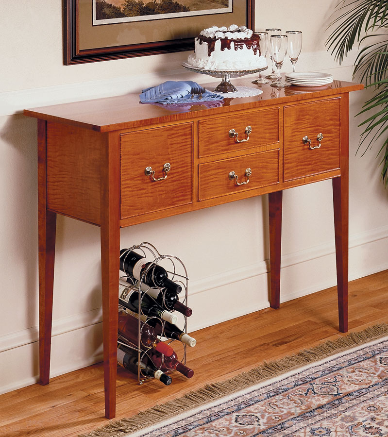 This traditional sideboard is a cross between a side table and a cupboard. Basically it's a small storage case on legs.