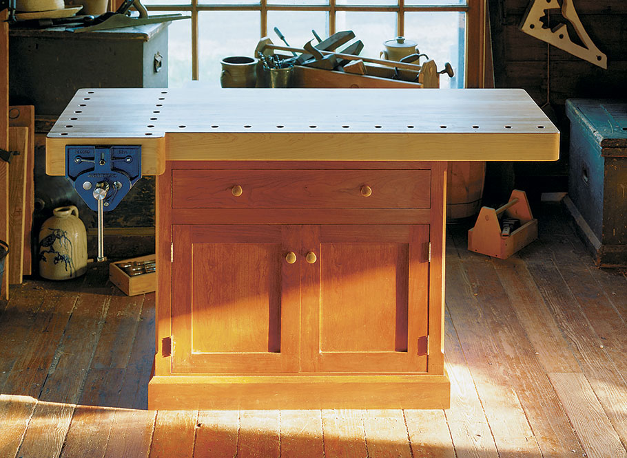 Sturdy and solid — nothing on this workbench is fragile. Even the metal vise features heavy wooden jaws, so it has a wide clamping surface and holds a pair of bench dogs.
