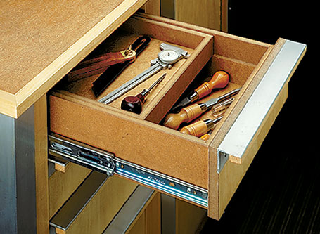 Plywood panels, solid-wood frame members, and heavy-duty hardware make this tool cart tough enough to stand up to just about anything.