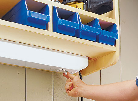 This simple storage shelf is great for a workshop, a garage, or any other place where you want to keep things close by — yet out of the way.