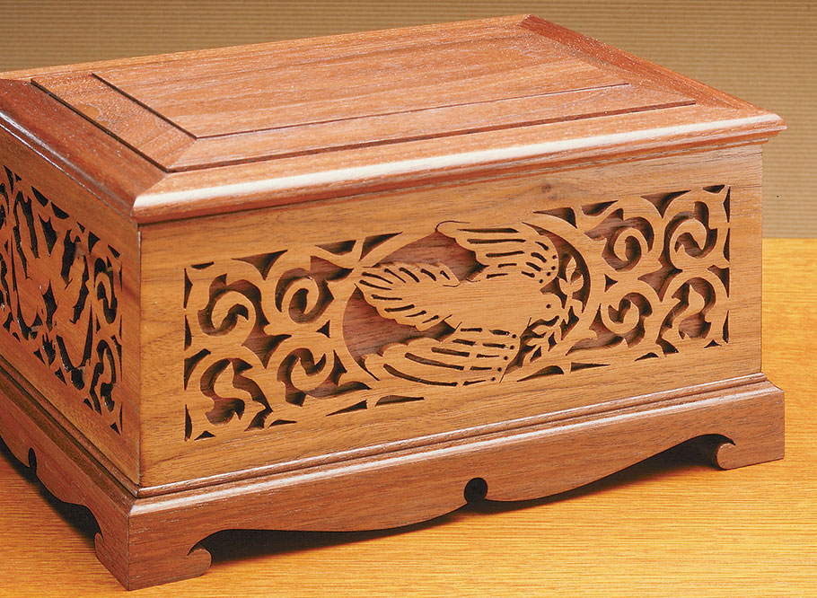 The elegant patterns on this box are first cut out with a scroll saw. Then the panel is glued to a backer board for a unique, almost-carved look.