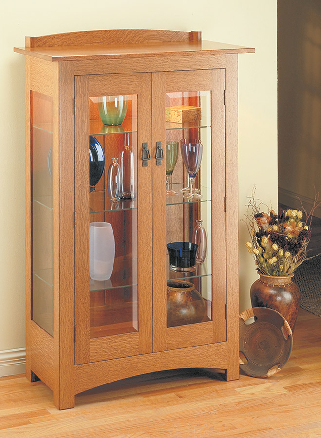 This curio cabinet combines all the features that make up a true Craftsman classic -- mortise and tenon joinery, quartersawn white oak, and period hardware. But it's the beveled glass that really makes this project shine.
