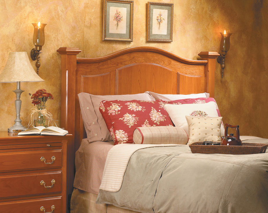Update your bedroom in a big way with a traditional hardwood headboard. It's a classic design with surprisingly simple construction.