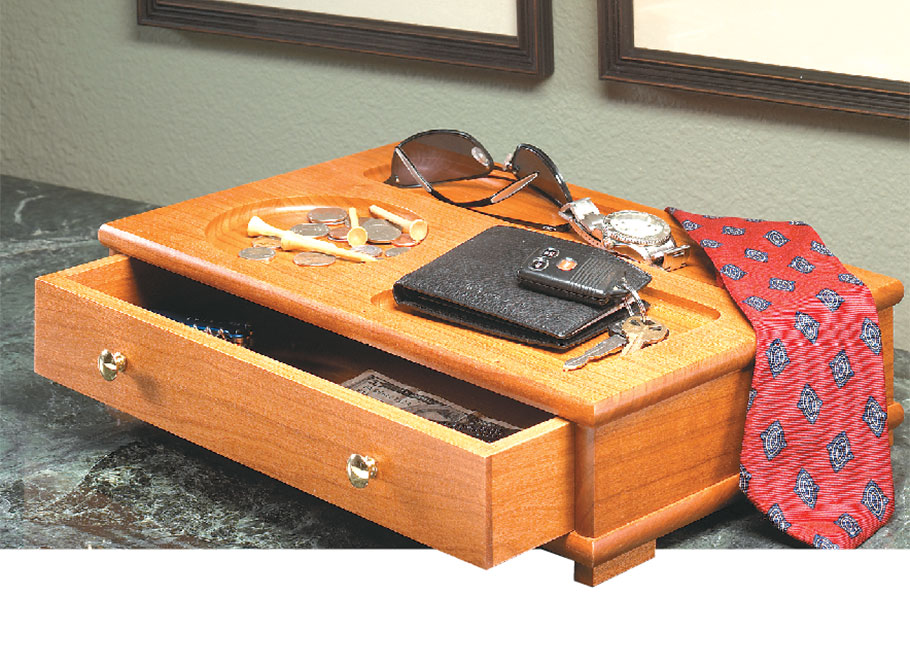 A divided-tray top and a small drawer make this box the perfect place to keep your everyday items close at hand.