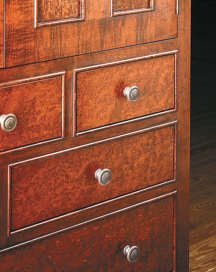 Why settle for ordinary? With bird's-eye maple veneer and combination of doors and drawers, this chest is stylish and functional.