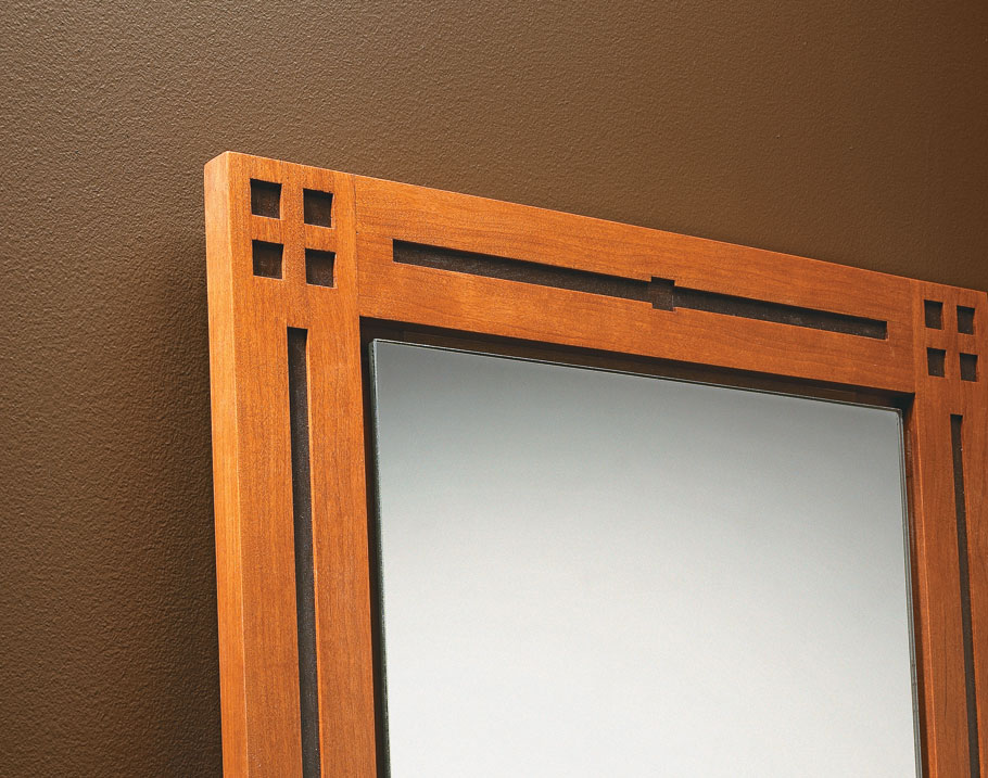 The decorative overlay, clean and simple details, and beautiful mix of hardwoods make this full-length mirror anything but plain.