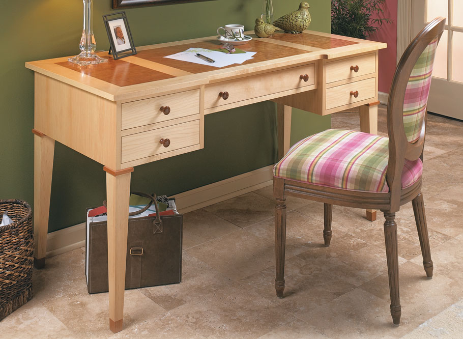 This desk has it all — a clean, elegant look and some great woodworking all wrapped into a compact and practical package.