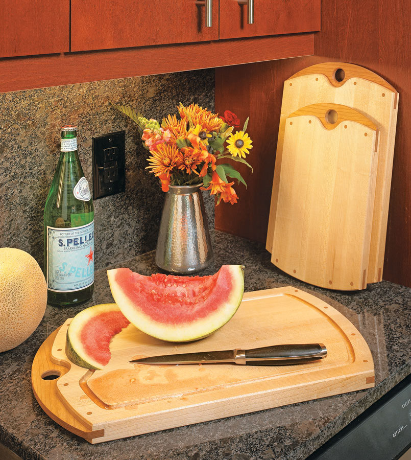 Sweeping arcs and cherry accents help make these kitchen accessories as attractive as they are practical.
