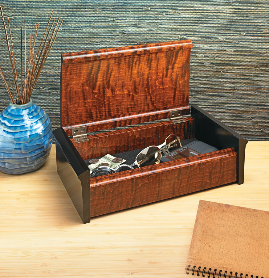 The unusual lid and ebonized sides of this attractive box show off the highly figured wood and your woodworking skills.