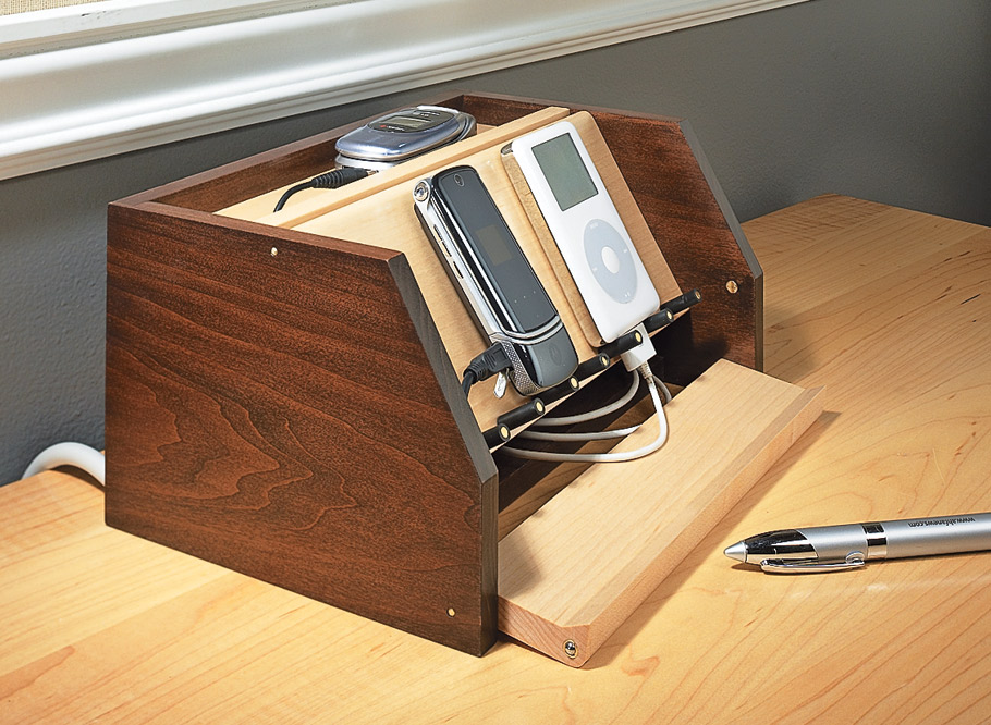 This handy caddy for electronic devices gives easy access to cords but keeps them out of sight and free from becoming a tangled mess.