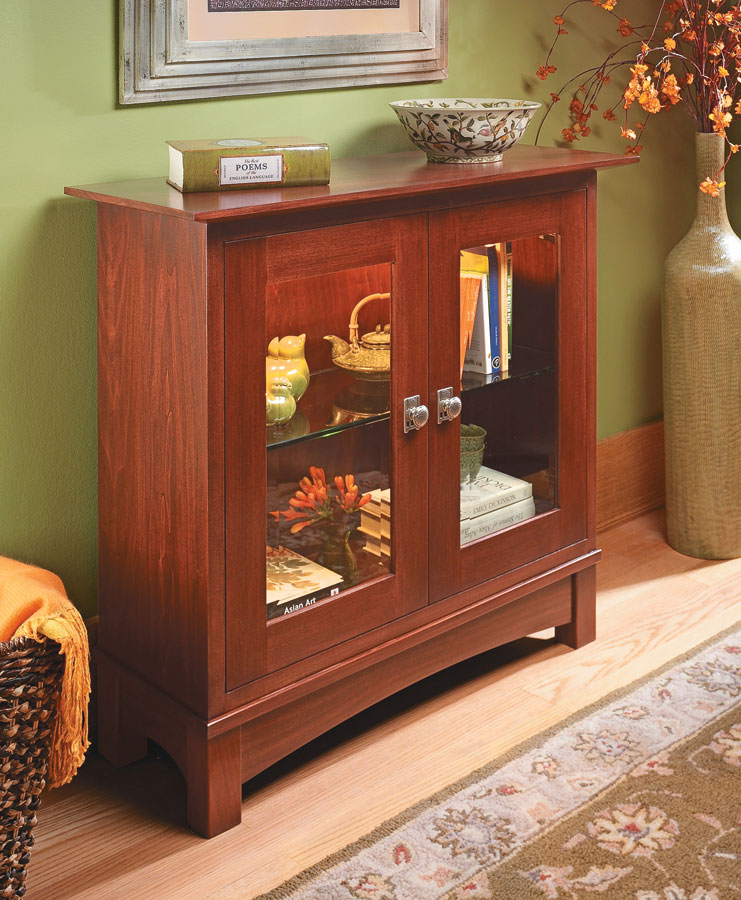 Stylish glass doors and interior lighting put the contents on display, but the design and construction of this cabinet hold a few surprises.
