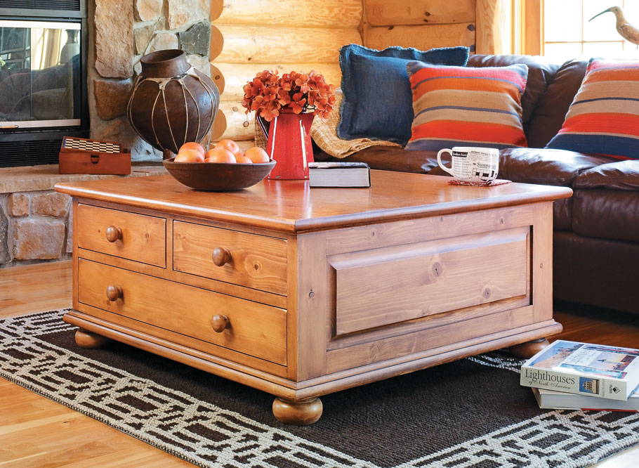 This table combines the rustic look of inexpensive pine with a practical design featuring loads of handy storage.