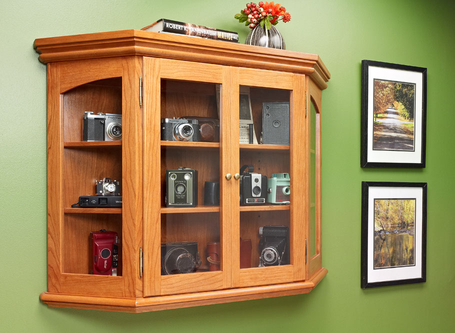 Keep the dust off of your collectibles and show them off in style with this attractive, wall-mounted cabinet.