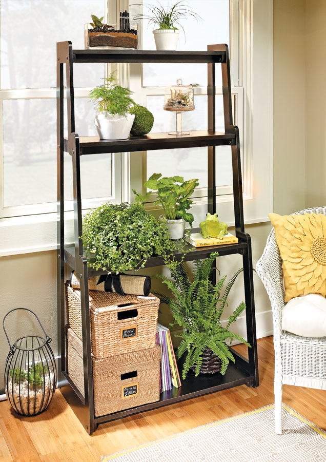 Turn some heads with this contemporary shelving unit. Its unique, knock-down design is great for displaying plants and so much more.