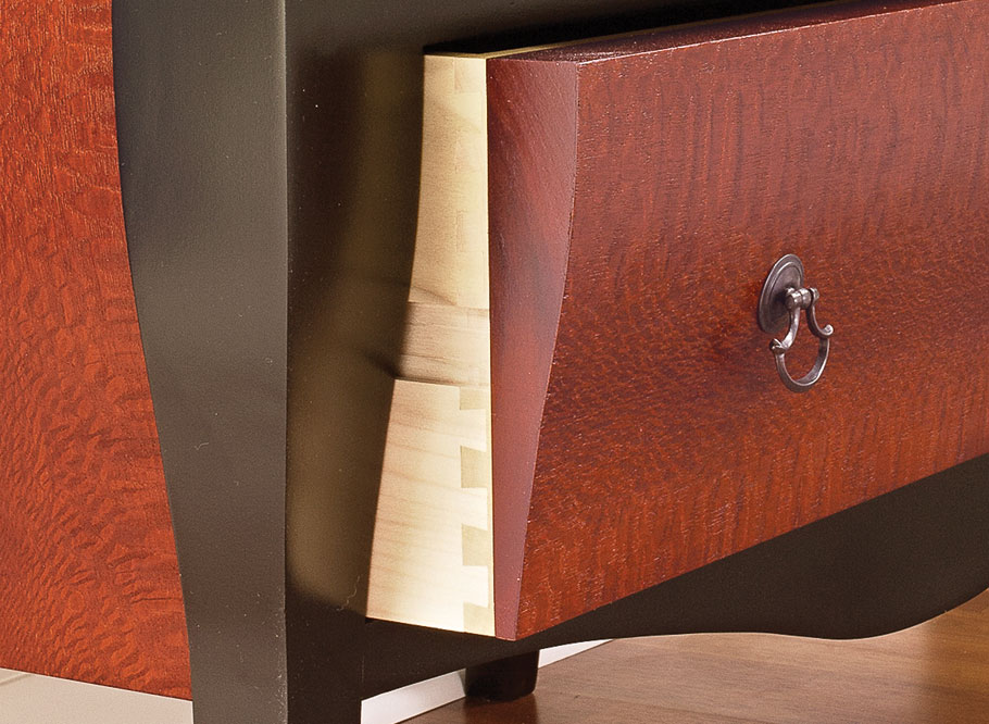 The flowing curves, breathtaking veneer, and large drawers make this elegant chest a fashionable and functional piece of furniture.